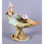 "A Royal Dux painted porcelain naturalistic pedestal bowl, surmounted a woman, 12"" high"