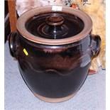 "Michael Casson: a studio pottery treacle glaze effect lidded two-handled bread bin, 13"" high"