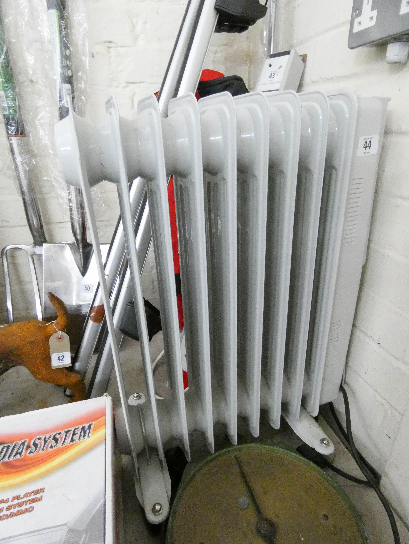 Lot 44 - An eight fin electric radiator