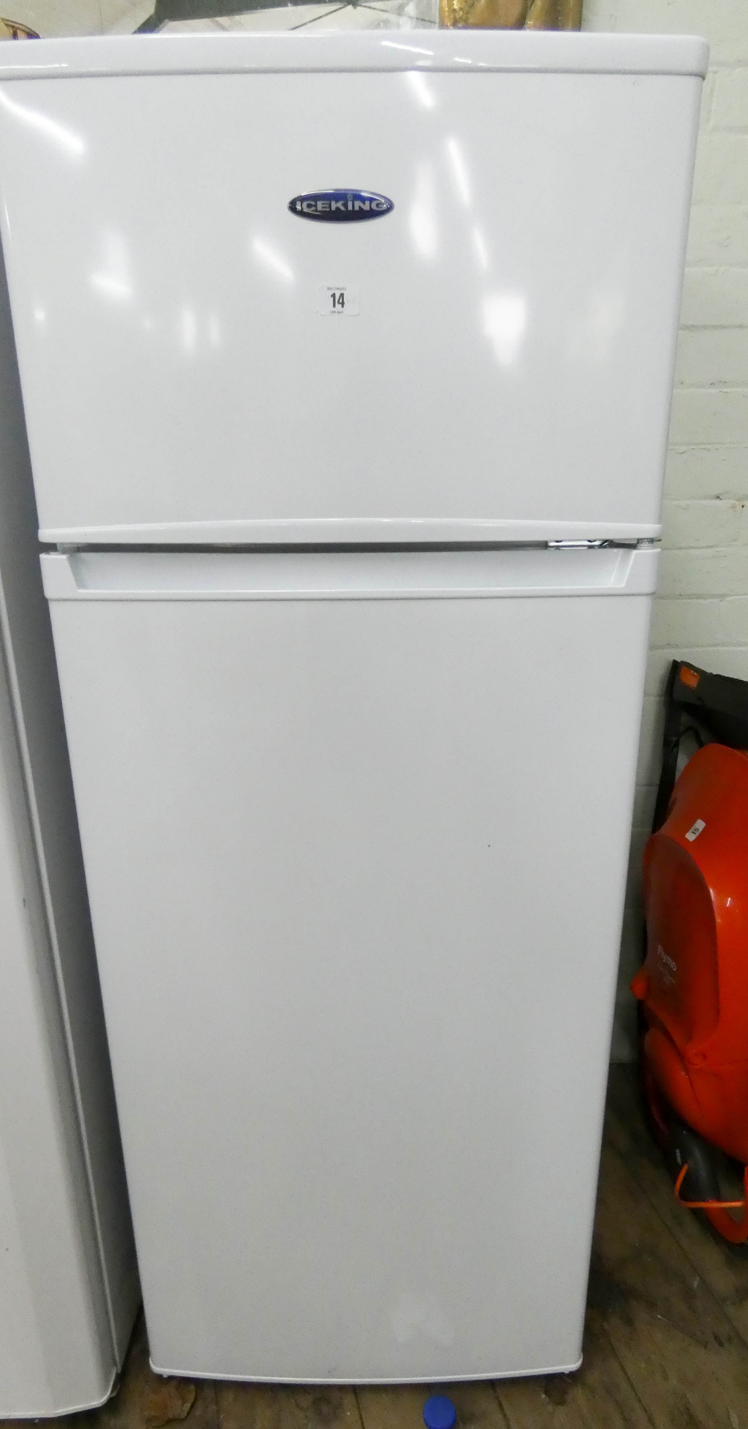 Lot 14 - An ice King fridge freezer with small freezer compartment on top