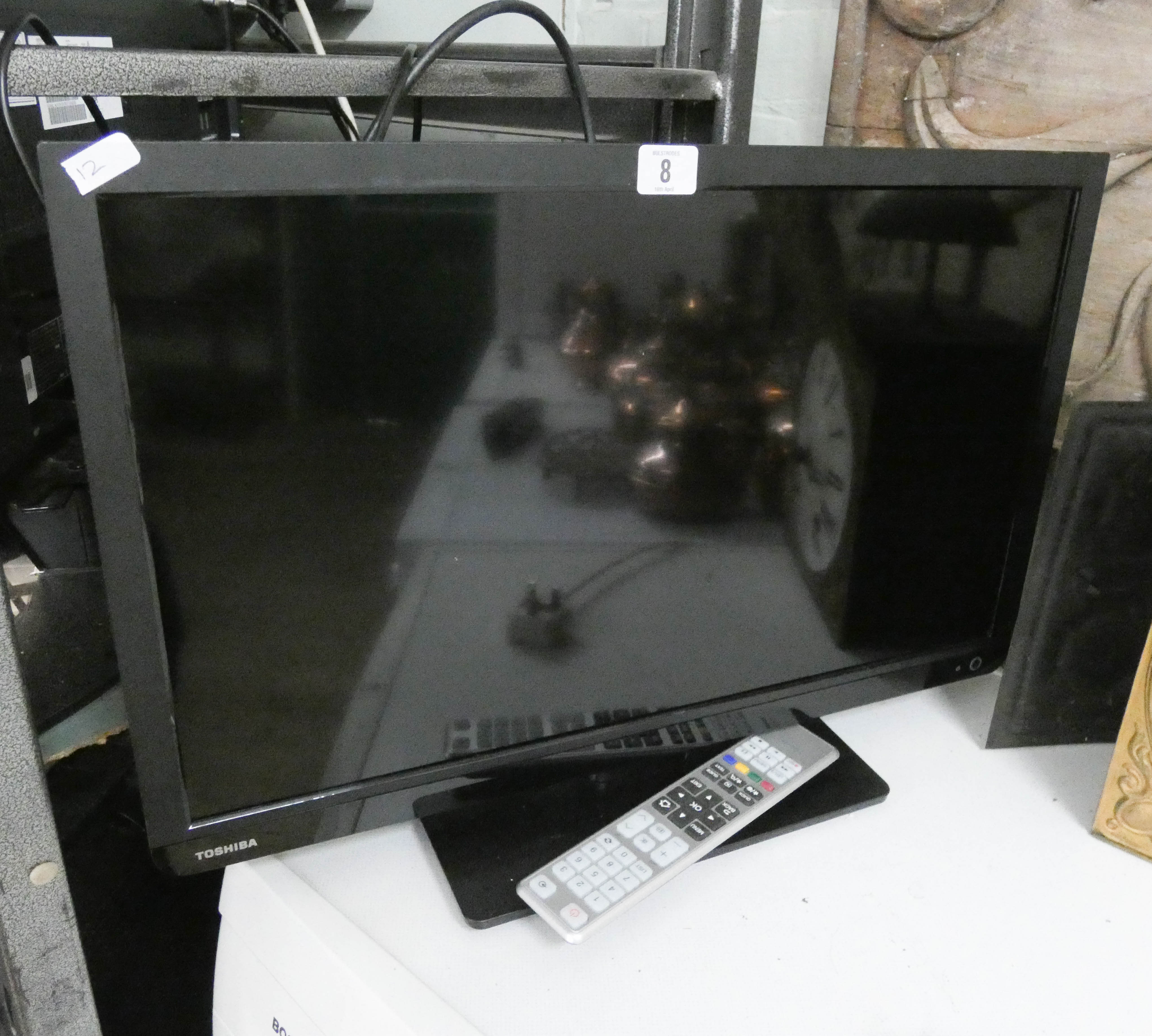 """Lot 8 - A Toshiba 24"""" digital LCD super slim line television with freeview etc,"""
