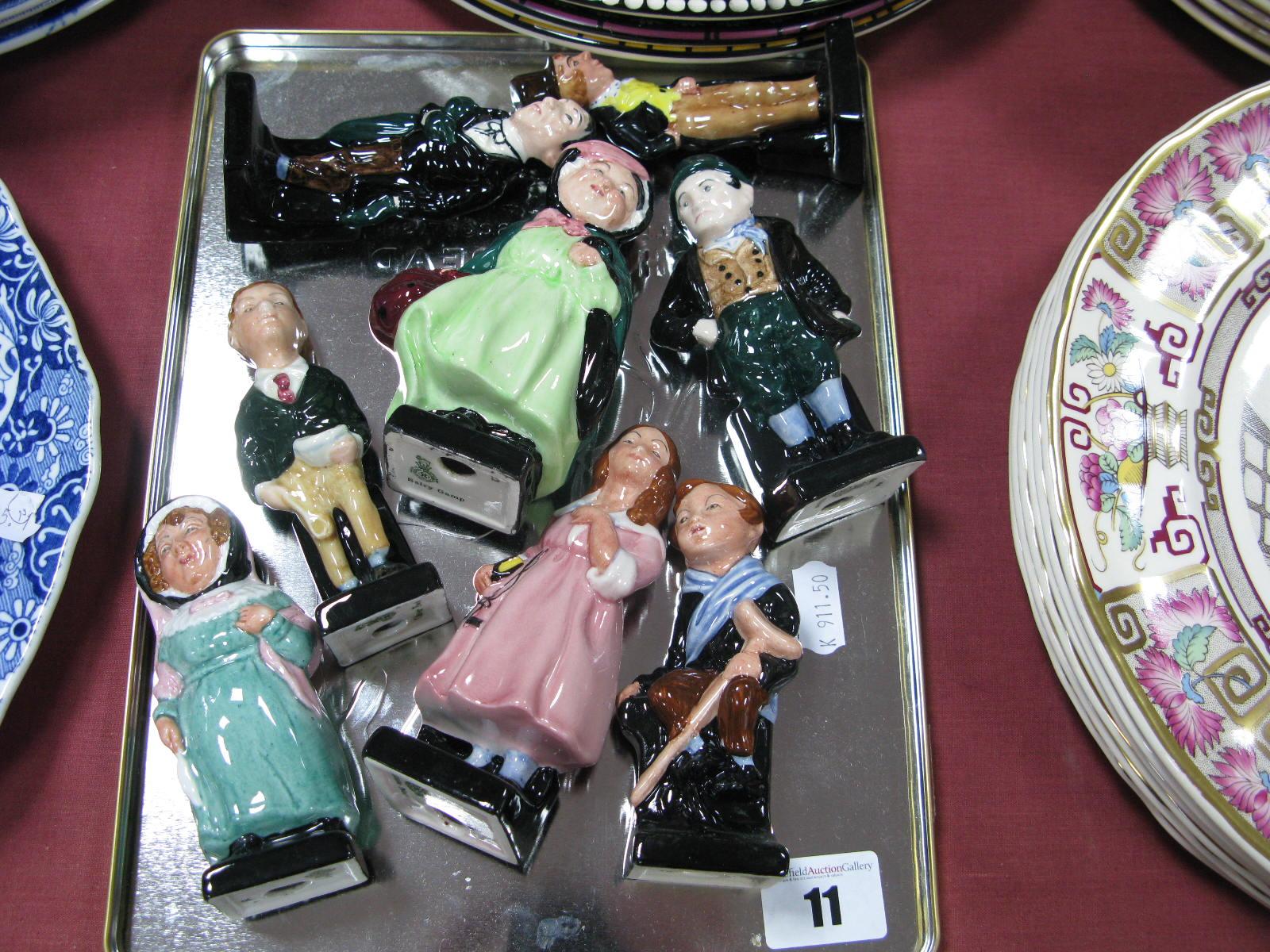 Lot 11 - Eight Royal Doulton Dickens Characters: Bill Sikes, Dick Swiveller, Sairey Gamp, Stiggins, Tiny Tim,