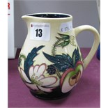 A Moorcroft Pottery Jug, painted in the Bramble Dell pattern by Nicola Slaney, limited edition no.