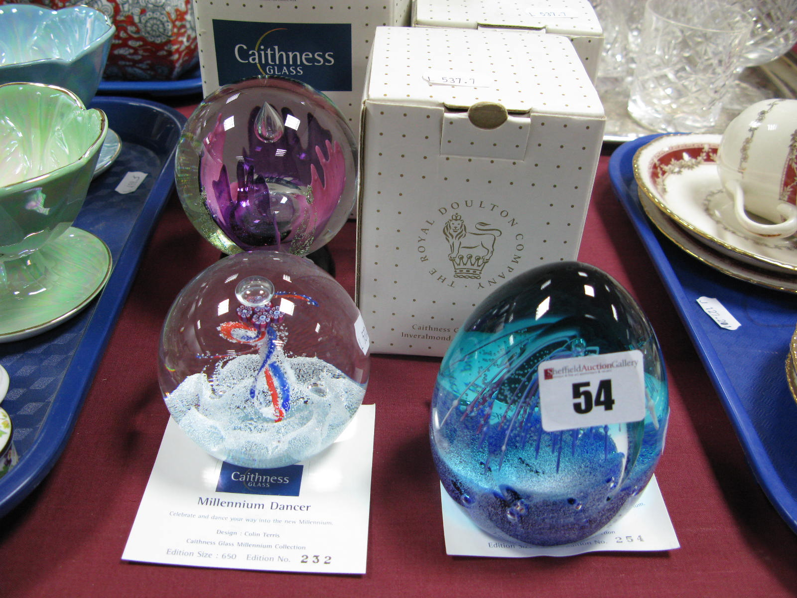 Lot 54 - Caithness Paperweights: Millennium Vision, limited edition No. 177; Millennium Fiesta No. 254/650