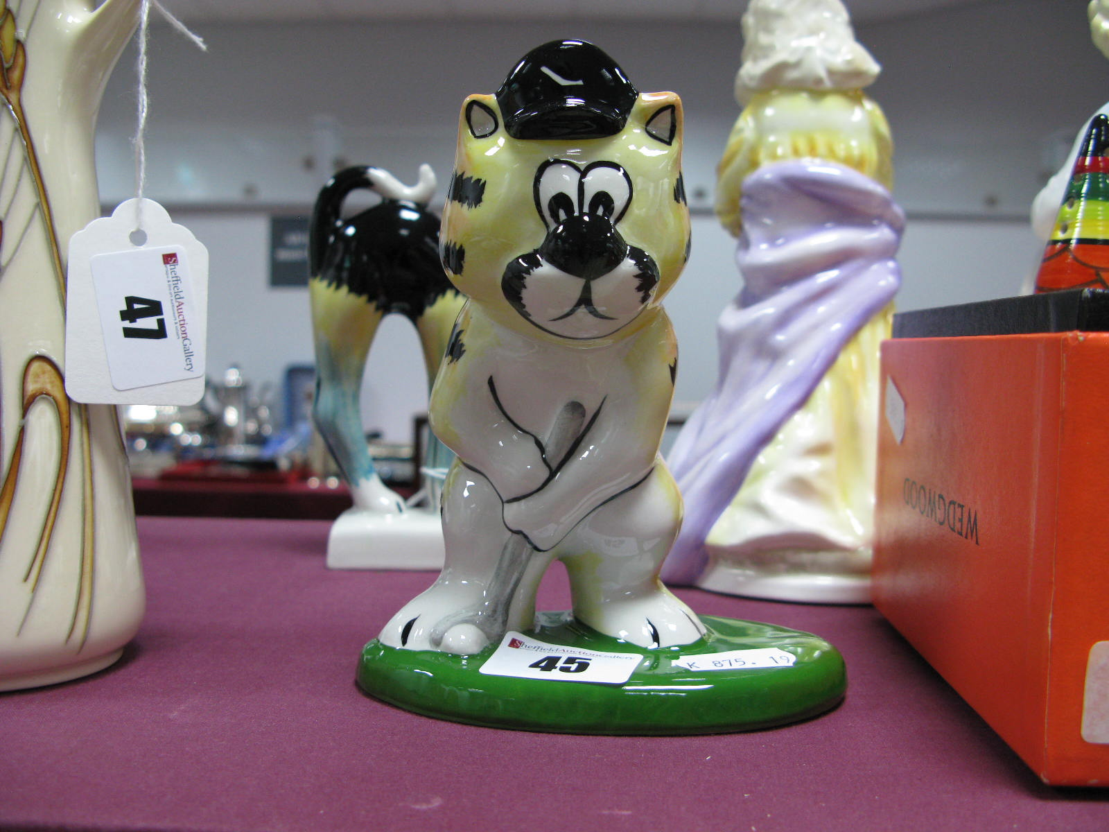 Lot 45 - Loran Bailey Cat - Tiger the Golfing Cat (Tiger Woods).