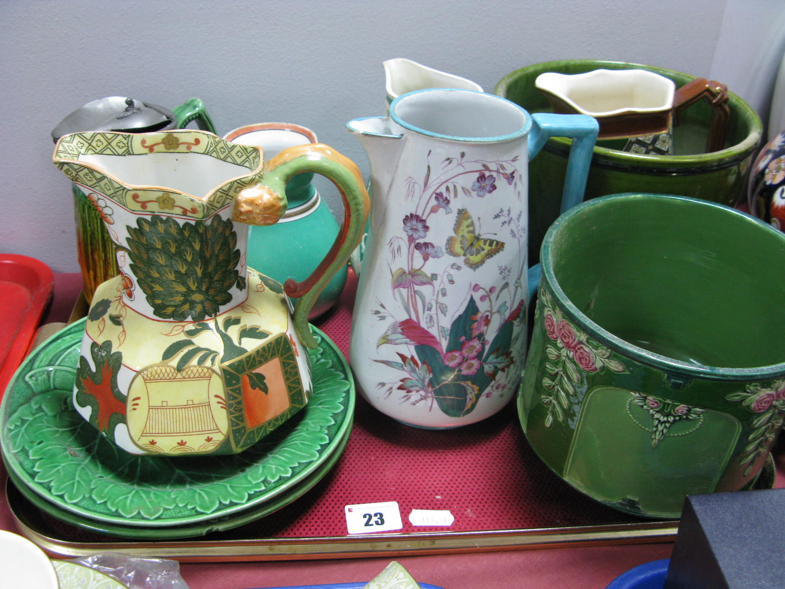 Lot 23 - Bretby and Eichwald Jardinieres, Wedgwood leaf moulded plates, Royal Doulton and other jugs:- One