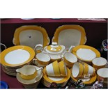 Grosvenor China Ye Old English Table Ware, of approximately fifty one pieces with mustard and gilt