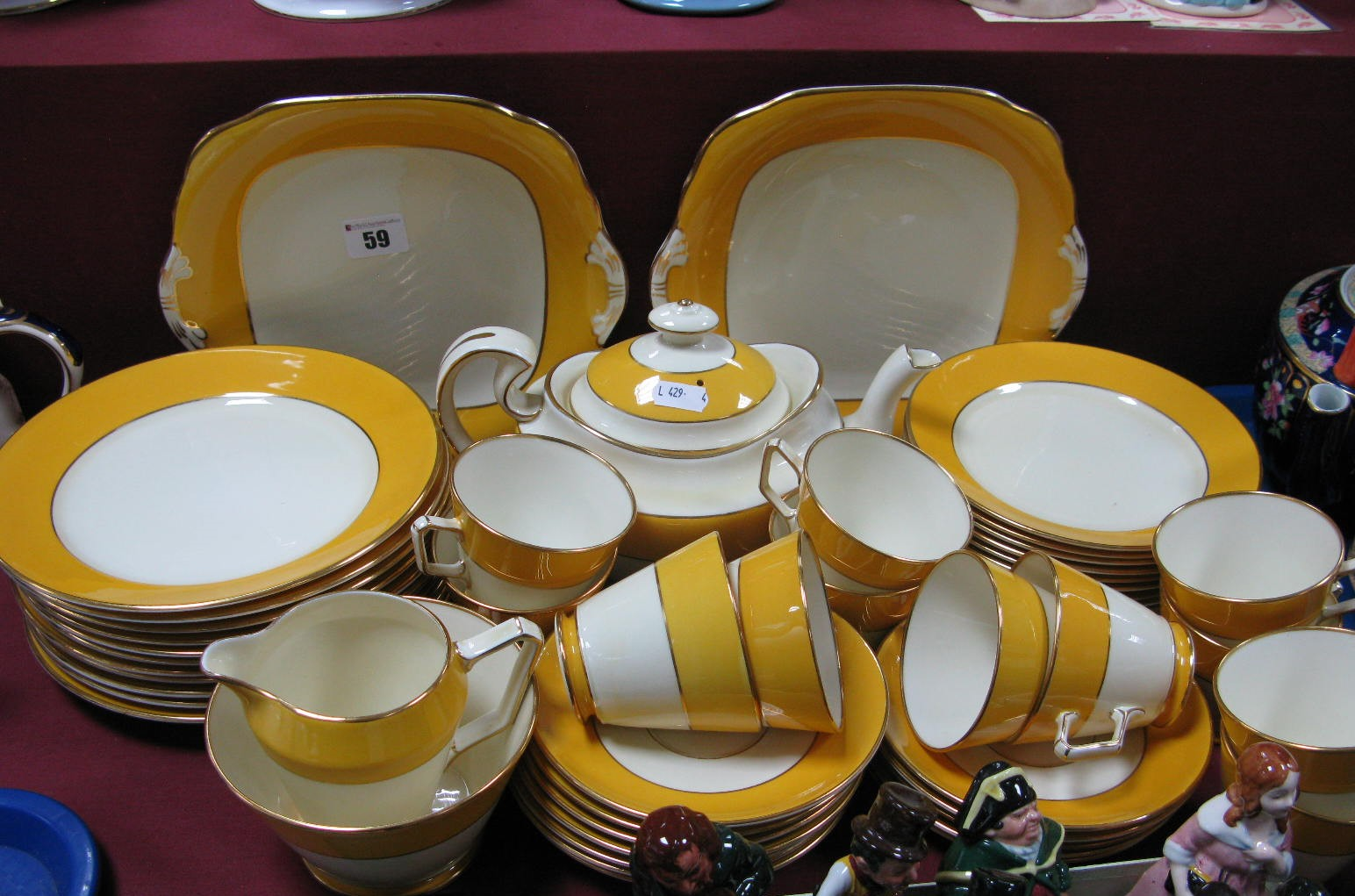 Lot 59 - Grosvenor China Ye Old English Table Ware, of approximately fifty one pieces with mustard and gilt