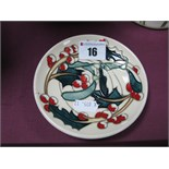 A Moorcroft Pottery Circular Coaster, painted in the 'Trial' Holly and Ivy pattern, shape 780/4,