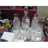 A Pair of Hobnail Whisky Decanters, gin decanter, whisky and brandy glasses, water bottle, plated