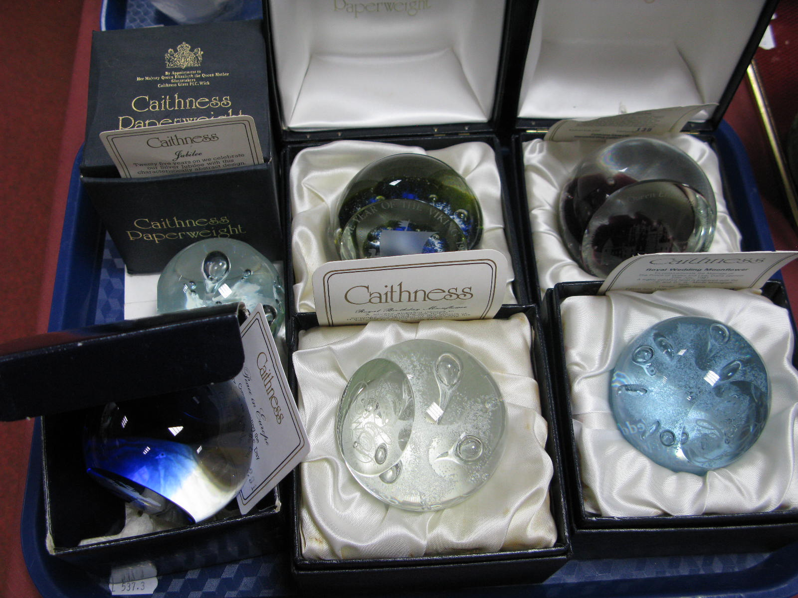 Lot 21 - Caithness Paperweights: Glamis Castle, limited edition No. 139/250; Royal Wedding Moonflower, No.