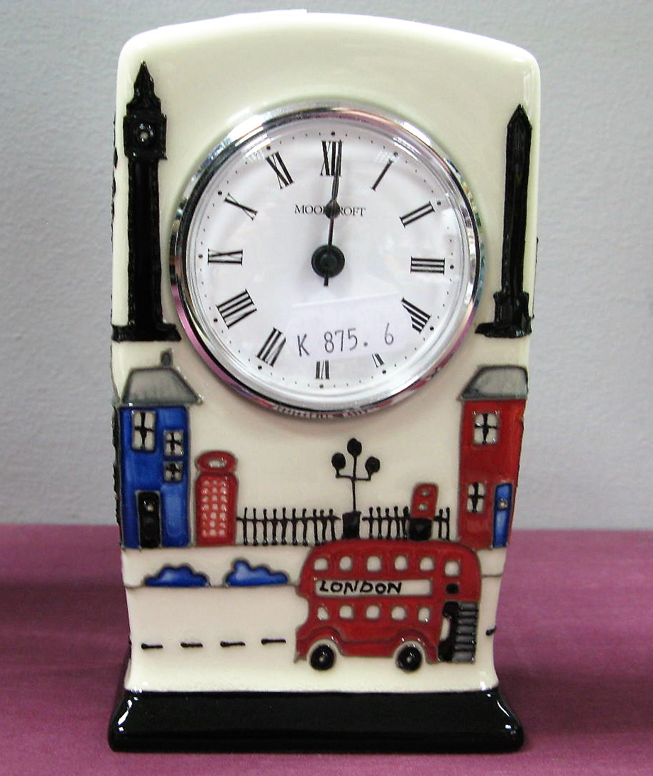 Lot 14 - A Moorcroft Pottery Clock, painted in the Londinium pattern by Nicola Slaney, impressed and