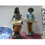 A Pair of Early XX Century Austrian Terracotta Figures, modelled as Moorish basket sellers in