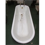 Cast iron enamel bath, white to the interior, black to the exterior, raised on four feet and