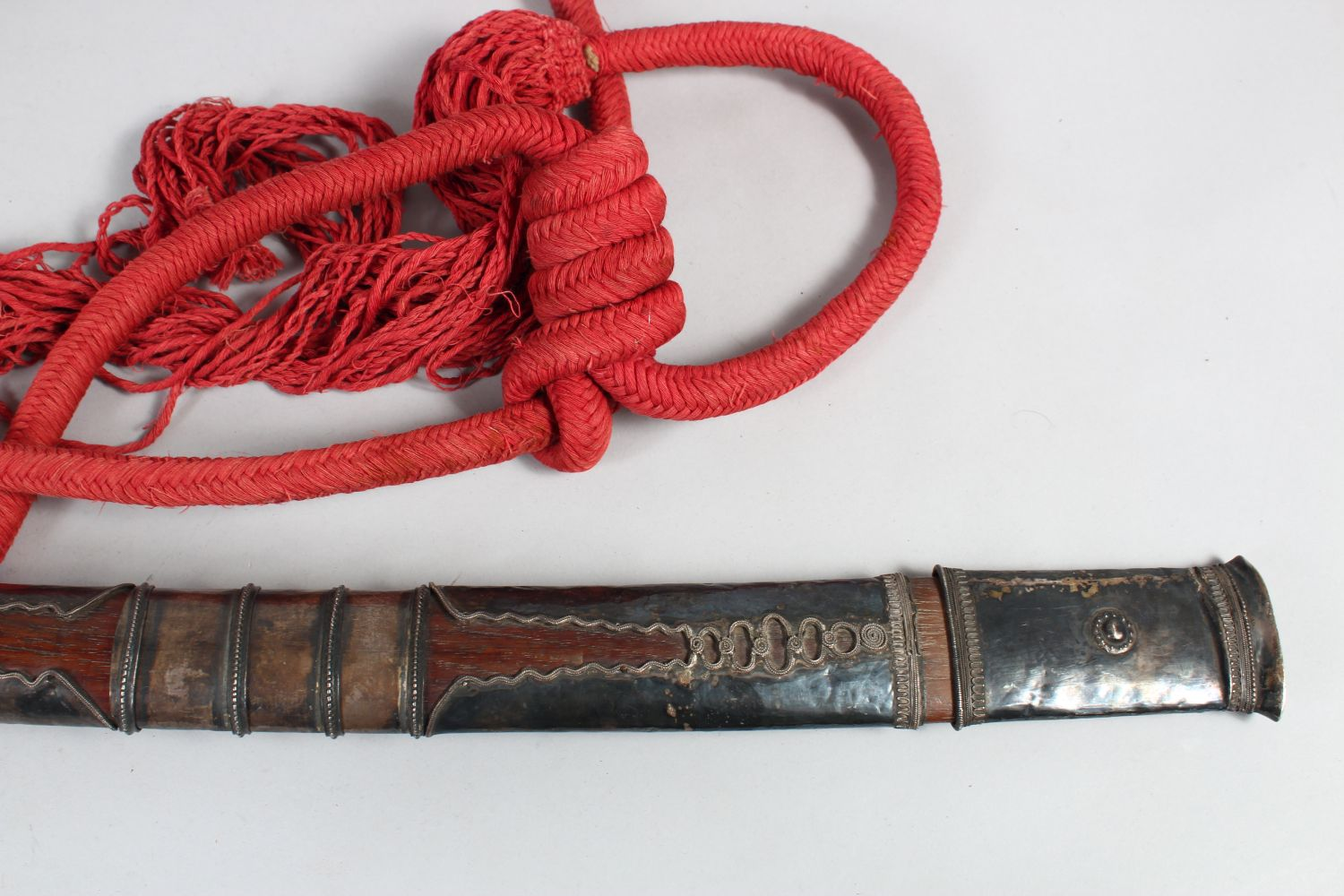Lot 28 - A 19TH CENTURY BURMESE IVORY HILTED SILVER MOUNTED DHA SWORD, with metal scabbard and rope, 84cm