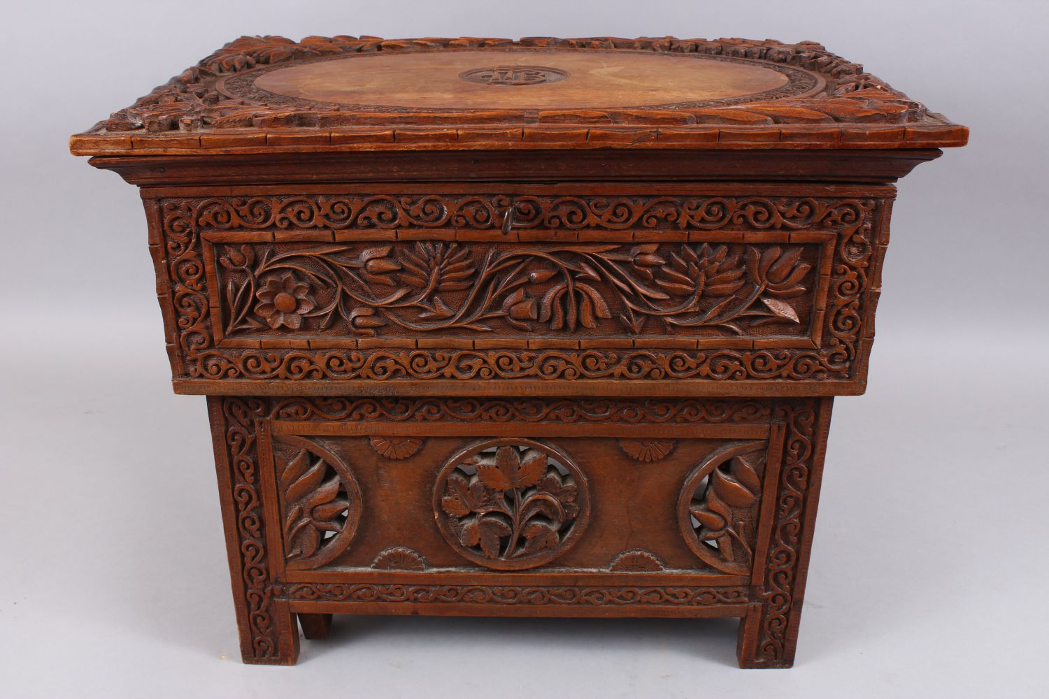 Lot 54 - AN 18TH / 19TH CENTURY INDIAN KASHMIR FOLDING WOOD MERCHANTS DESK, carved in deep relief to depict