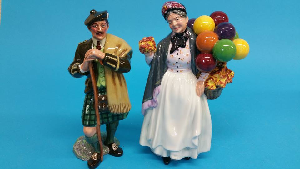 Lot 6 - A Royal Doulton figure 'Biddy Penny Farthing' HN 1