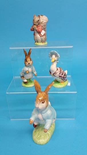 Lot 55 - Four Beswick England Beatrice Potter figures, brow