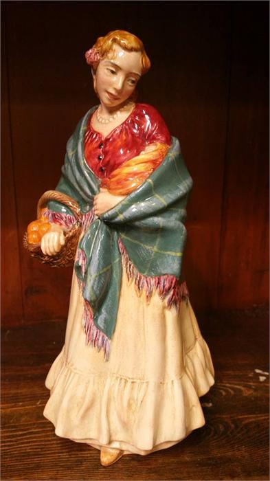 Lot 53 - A Doulton and Co. figure of a Romany lady holding