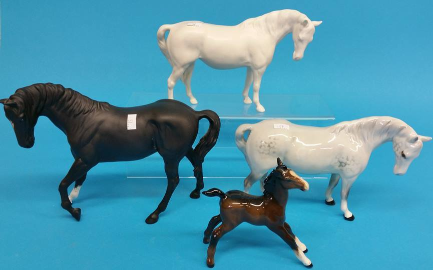 Lot 57 - A Collection of four Beswick horses