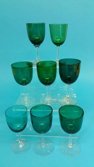 Lot 38 - Eight small wine glasses with green bowls and clea