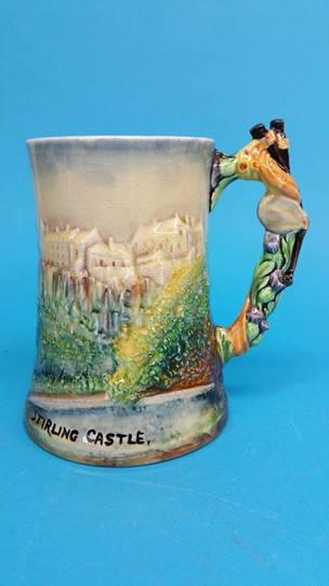 Lot 34 - A Presenta musical tankard, showing Stirling Castl