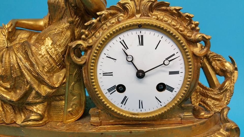 Lot 22 - A Continental gilt metal mantel clock with white e