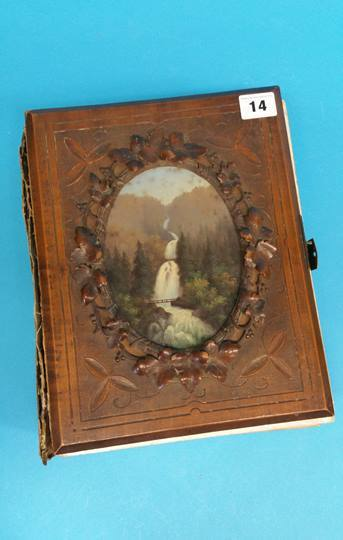 Lot 14 - A Victorian carved walnut fronted photograph album