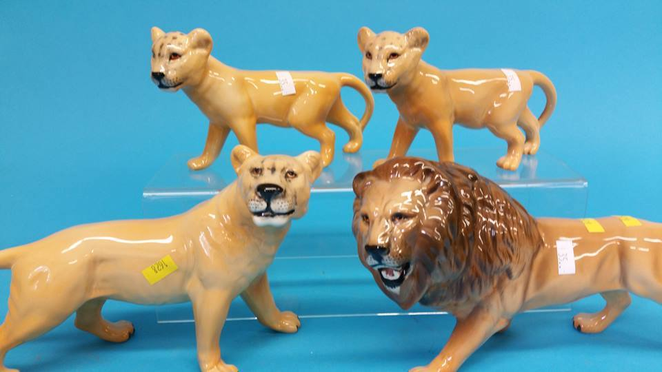 Lot 35 - A Pride of Beswick lions and lionesses (4)