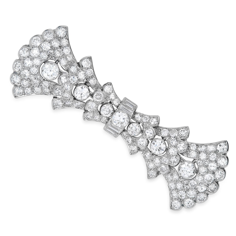 Los 58 - ANTIQUE ART DECO DIAMOND BROOCH, CARTIER set with round and baguette cut diamonds, signed Cartier,
