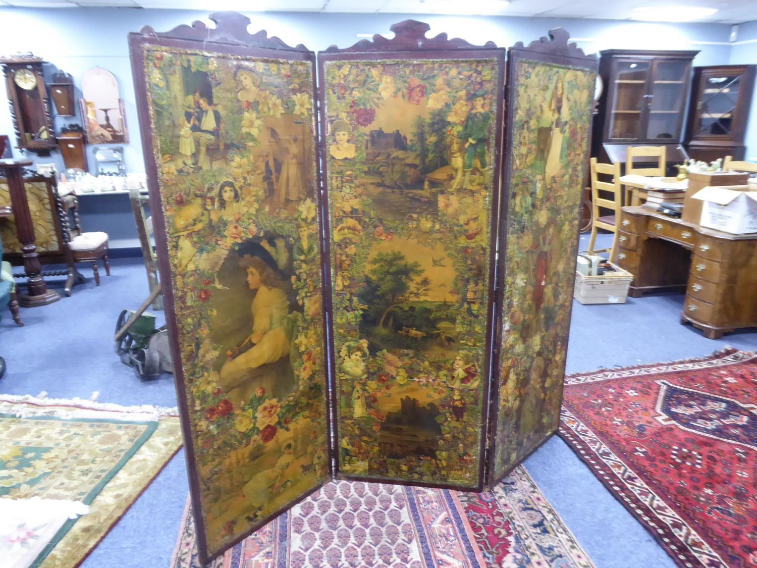Lot 205 - LATE VICTORIAN THREE FOLD DOUBLE SIDED SCRAP SCREEN, the frame stained mahogany and with shaped