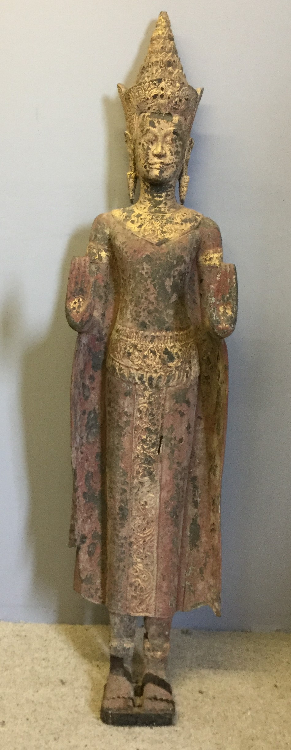 Lot 207 - A large Cambodian polychrome decorated carved wood standing Buddha 168 cm high.