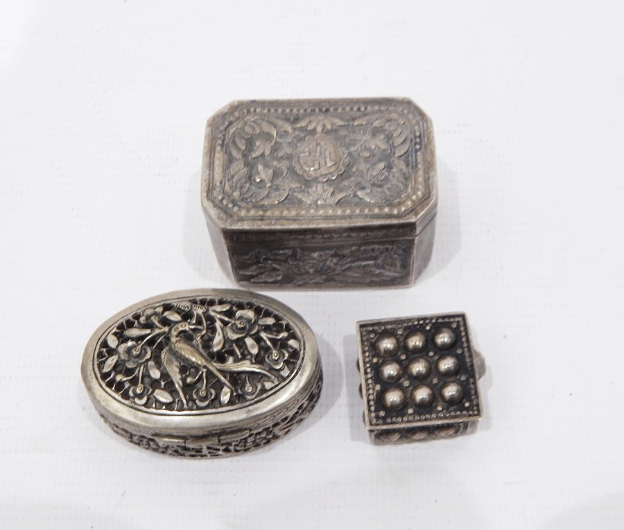Lot 435 - Cambodian silver-coloured metal nut box, rectangular with chamfered corners,