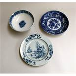 A 19th century Chinese Jiaqing period blue and white stem bowl, a blue and white qianlong plate,