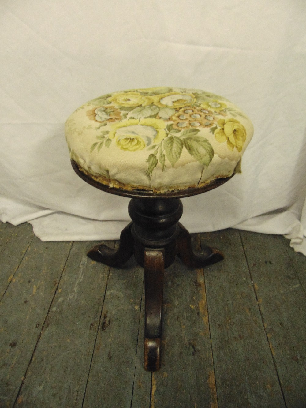 Lot 30 - A Victorian circular piano stool on three outswept legs