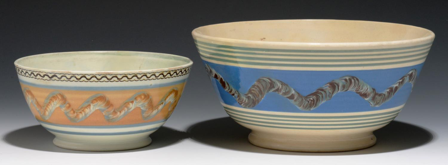 Lot 297 - TWO MOCHA WARE BOWLS, MID 19TH C  decorated with a multichambered slip pot with bands of cat's