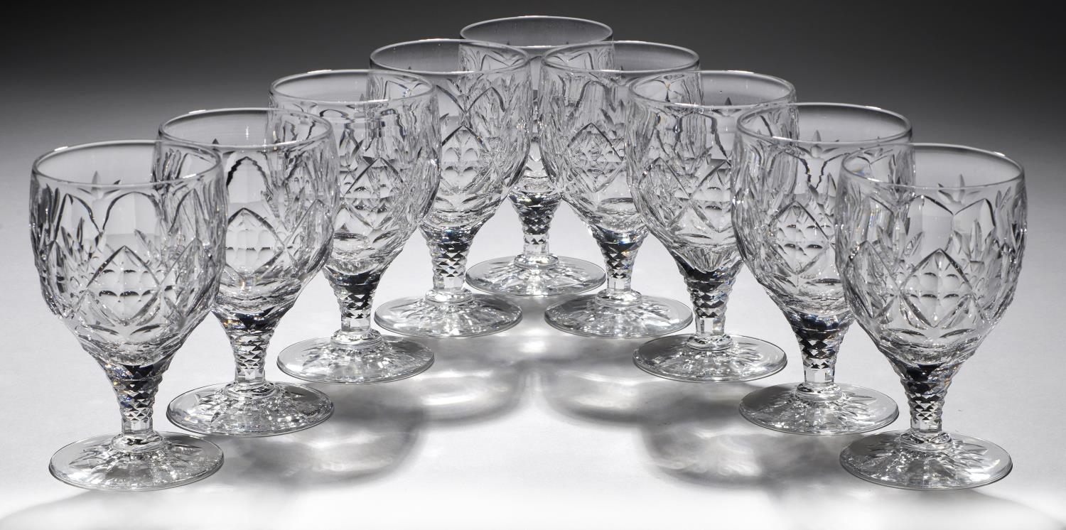 Lot 364 - A SET OF NINE ENGLISH DIAMOND CUT GLASS GOBLETS, SECOND QUARTER 20TH C  on faceted stem, star cut