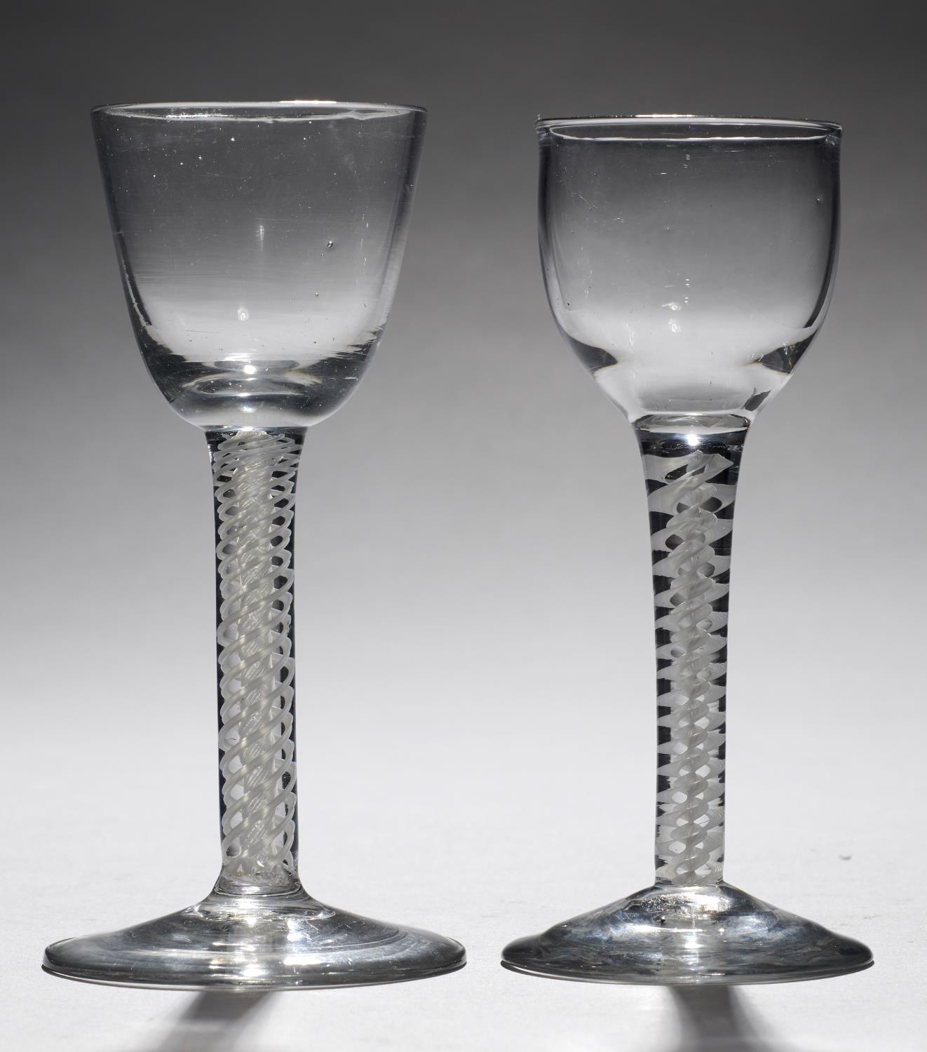Lot 363 - AN ENGLISH WINE GLASS, C1770 the lipped ovoid bowl on double series opaque twist stem and stepped