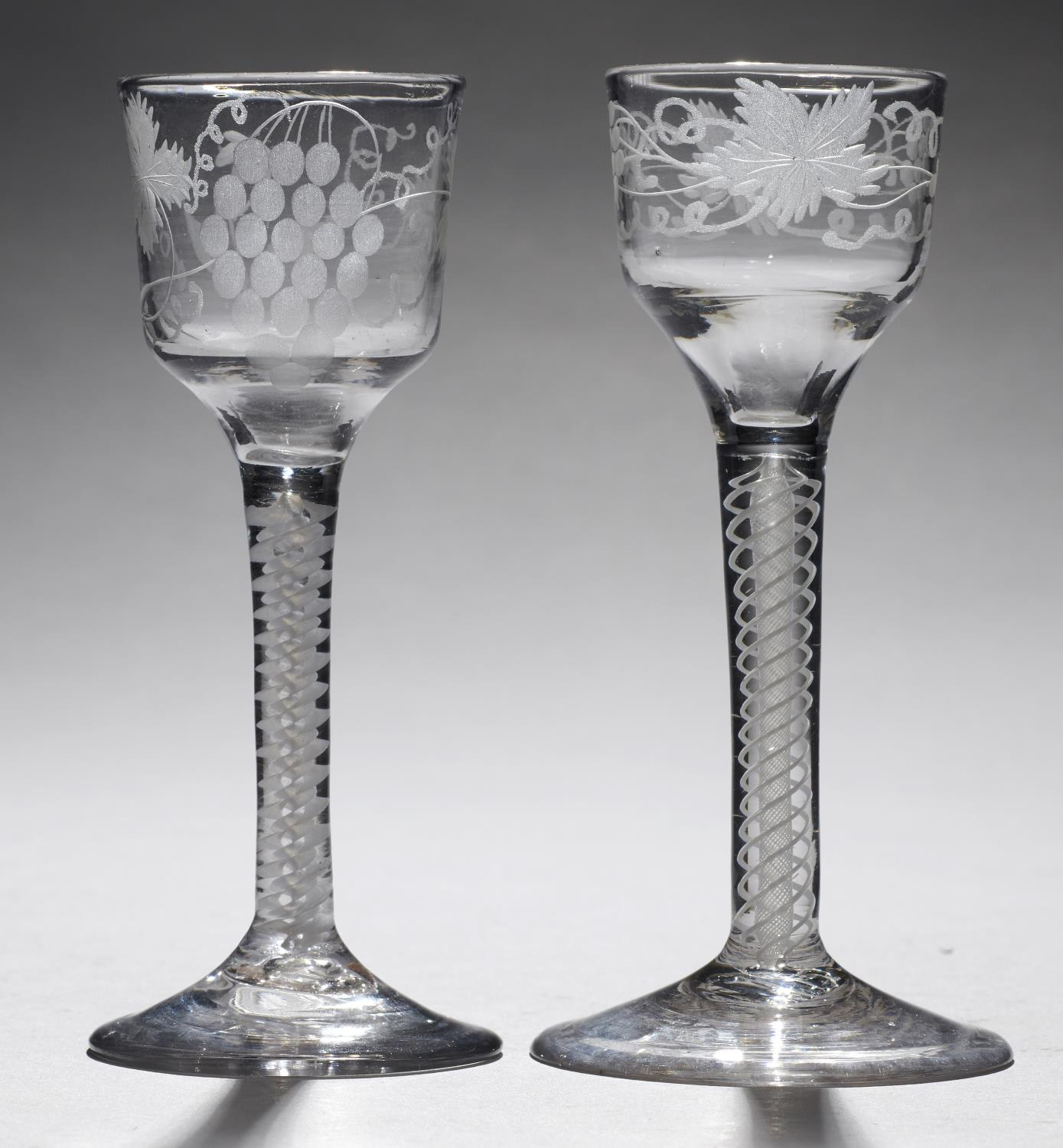 Lot 362 - TWO ENGLISH WINE GLASSES, C1770  the ogee bowl engraved with grapevines on double series opaque