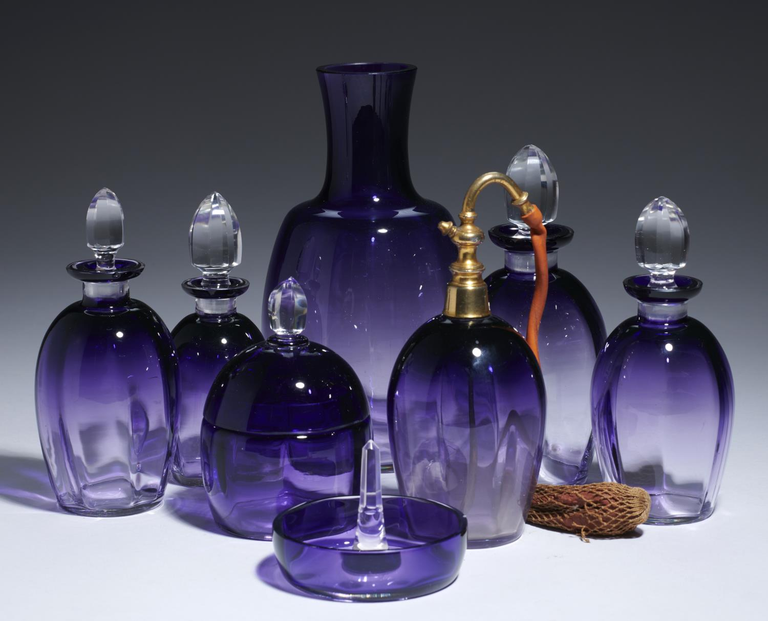 Lot 219 - A FRENCH AMETHYST GLASS DRESSING TABLE SET, C1930  including a scent bottle with giltmetal
