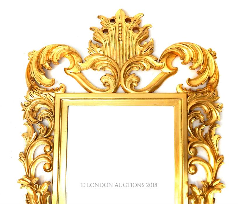 Lot 15 - A large carved giltwood wall mirror