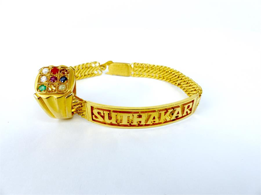 Lot 28 - A 22 ct yellow gold bracelet and 22 ct yellow gold, gem-set ring
