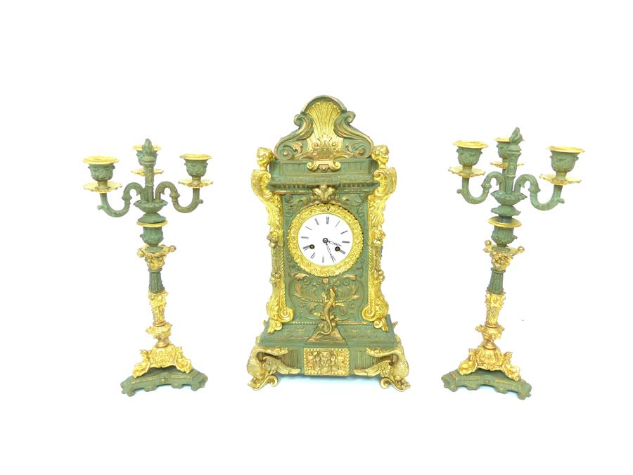 Lot 10 - A painted and gilt metal clock garniture