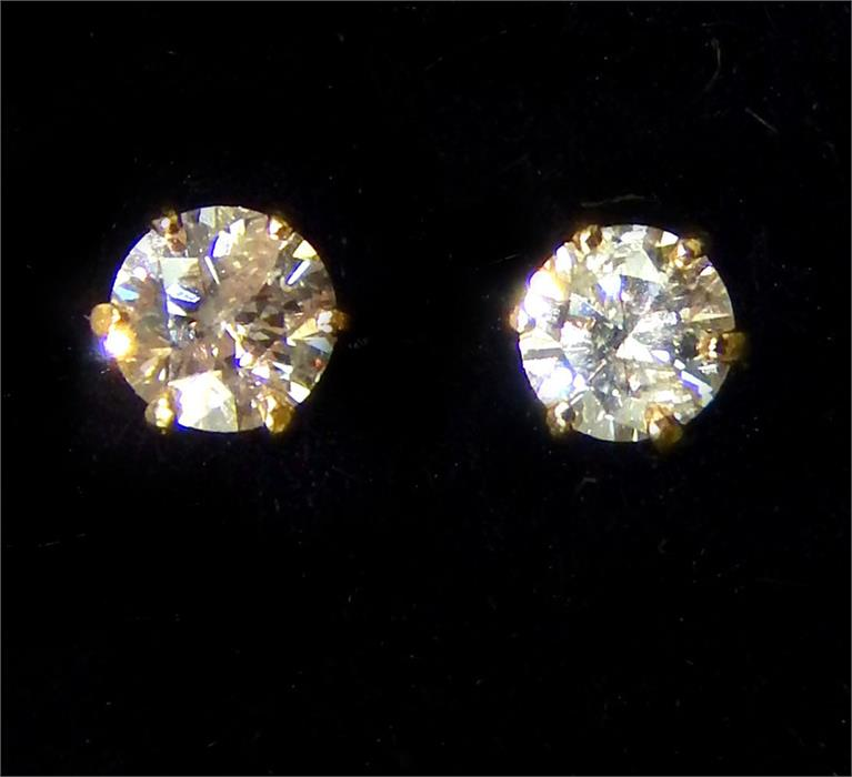 Lot 11 - A boxed pair of 18 ct yellow gold, diamond stud earrings (Total 0.10 carats)