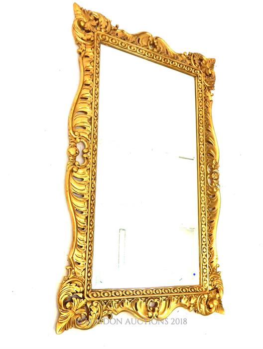 Lot 17 - A giltwood framed wall mirror