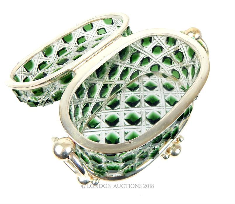 Lot 38 - A green cut glass trinket box