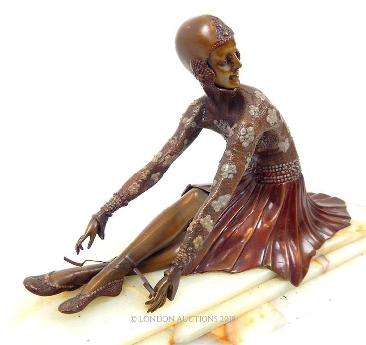 Lot 30 - An Art Deco style bronze figure of a seated ballerina