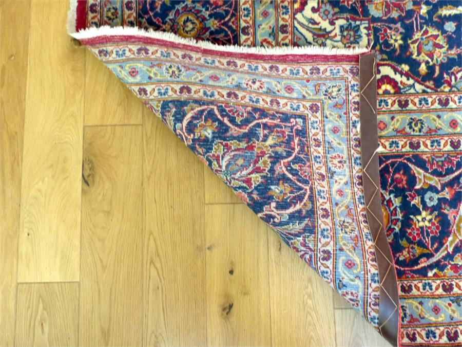 Lot 41 - A large antique Persian Kashan carpet