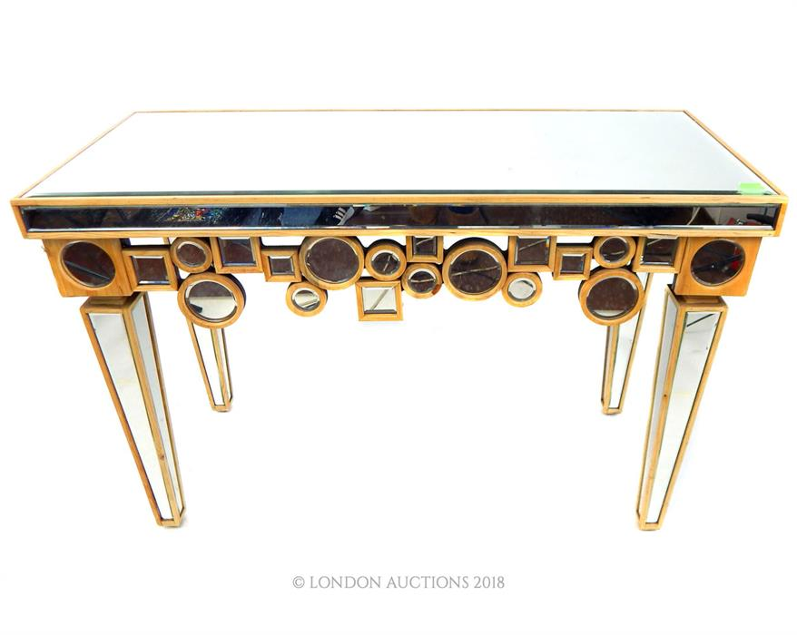 Lot 42 - A contemporary console table formed of bevelled mirrored panels