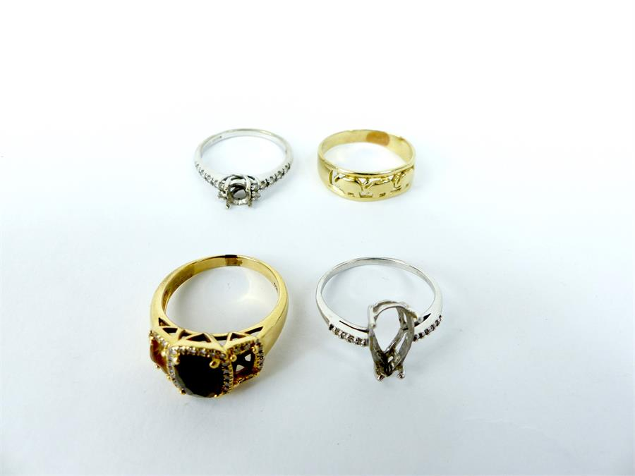 Lot 49 - Four yellow and white gold rings (missing stones)